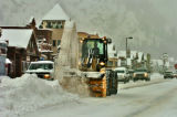 Work crew clear snow from the middle of Main St. Thursday morning January 19, 2006 in Frisco...