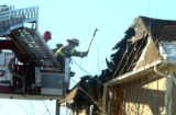 Aurora firefighters finish putting out a house fire in the 4200 block of S.Halifax Way in Aurora...