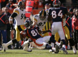 14 Denver wide receiver Charlie Adams gains yardage on a punt return in the first quarter against...
