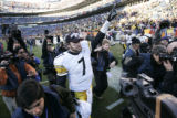1401 Steelers quarterback #7 Ben Roethlisberger points to the sky in victory as he walks off the...