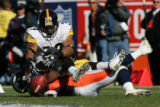 1483 Steelers #39 Willie Parker fumbles the ball as he is brought down by Broncos #56 Al Wilson...