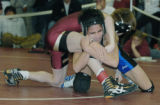 Lafayette, CO Jan. 20, 2006 Dale Schull of Ft. Lupton (bottom) trys to take down Zeke Hofer of...