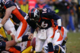 1811 Broncos quarterback #16 Jake Plummer fumbles the ball on a fourth and 10 to go during the...