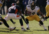 1996 Pittsburgh Steelers running back Willie Parker runs toward Denver's Champ Bailey during the...