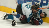 (DENVER, COLO.,  May 4, 2004)  Colorado Avalanche's #21, Peter Forsberg is taken down against the...