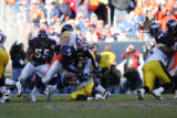 323 Steelers #36 Jerome Bettis is brought down by Broncos #96 Michael Myers during the third...