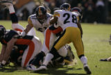 386 Broncos #38 Mike Anderson struggles to gain yards against Steelers #28 Chris Hope at Invesco...