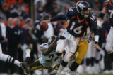 607 Denver's #16 Jake Plummer shakes Pittsburgh's #24 Ike Taylor before making a pitch to #38 Mike...