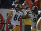 666 Steelers wide receiver #86 Hines Ward celebrates his touchdown with running back #34Vernon...