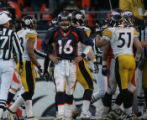 713 Broncos #16 Jake Plummer turns and looks down the field after a short gain by the offense...