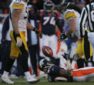 769 Broncos #80 Rod Smith throws the ball up while lying on the ground during the third quarter at...
