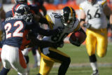 930 Steelers #80 Cedrick Wilson pushes back against Broncos #22 Domonique Foxworth during the...