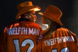 Broncos fans James Gallaher, cq, 37, and his wife Holli Gallaher, cq, 38, both of Denver pose for...