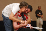 (Denver, Colo., June 13, 2004) Janet Patterson (cq), of Conway, KS, is embraced by friend,  Carlos...
