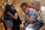 (Denver, Colo., June 13, 2004) From left- Pat Clancy hugs Ann Hitchins, center left, both of...
