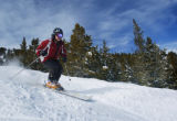 Joe Falconer(cq), founder of The Colorado Ski Club, races down the slope at Breckenridge Ski Resot...