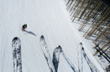 Ski tips of a few members from the Colorado Ski Club stick out from a ski lift as they make their...