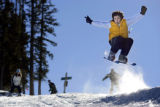 Jorge Barrera (cq), 18, of Monterrey, Mexico catches some air off a small jump on snowblades on...