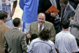 Denver Nuggets head coach George Karl talks to his team during a time out in the third quarter of...