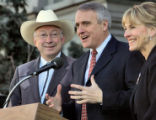 U.S. Senator Ken Salazar, left, and Barbara O'Brien, right, stand by democratic candidate for...