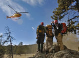 Members of the Rocky Mountain Rescue Group watch as a Flight For life helicopter leaves with Shaun...