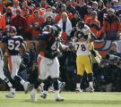 08 Pittsburgh's Max Starks (78) celebrates with Cerick Wilson after the wide receiver made a...