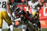 1288 Broncos #80 Rod Smith makes some headway as he is brought down by Steelers #??? during the...