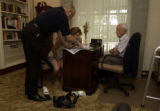(BRUSH, Colo., June 9, 2004) Stan comes in to help his daughter Carrie read to Harold. Stan had...
