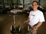 KAS023 Sanford Greenberg (cq) sells Segway Human Transporters from his dealership, First Class...