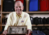 KAS050 Pete Paradise holds a selection of pens in the company headquarters and outlet store for...