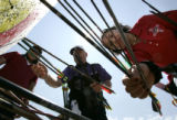 Leandra Jones (cq) 16 of the Navajo Nation with team New Mexico retrieves her arrows during a warm...