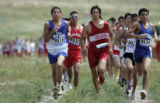 Runners make their way through the course as they run in the 5K event  at the cross country venue...