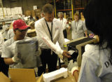 (Denver, Colo., June 14, 2004)  EchoStar CEO Charlie Ergen lends a hand on the assembly line,...