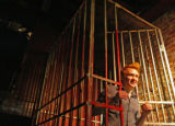 KAS120 Mick Lambuth (cq) emerges from a cage after he was auctioned off for a date at Mollypalooza...
