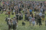 Over ten thousand Rainbow Family members make their way to form a prayer circle on Tuesday morning...