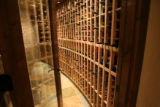 "DLM7013  A humidor stores racks of wine in the basement of ""La Grande Cannoli,"" designed..."