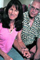 MJM065  Joanne James, 56, left, sits beside her boyfriend Dennis Christensen, 58, on Wednesday,...