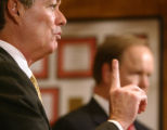 Colorado Governor Bill Owens, left, speaks at a press conference with Rick Grice, executive...