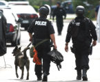 A Loveland Police K-9 unit was called after Joshua Christianson ,18, a U.S. Marine, held an  AR-15...