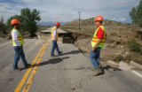 L to R: CDOT workers Chuck Decker (cq), Chuck Bennett (cq), and Robert Fontenot (cq) evaluate a ...