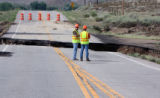 L to R: CDOT workers Scott Dalton (cq) and Robert Fontenot (cq) evaluate a  large section of Hwy....