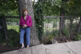 Anita Hamilton, (cq), 79, in the backyard of the home she built where her daughter still resides,...