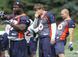 Denver Broncos rookie quarterback Jay Cutler, middle, during team stretches on the opening day of...