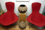 (DENVER, CO., June 21, 2004) American designed chairs with Zulu baskets acquired from Africa by...