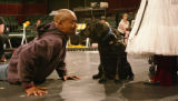KAS411 Leonard Barrett sings to Deidra, a seeing eye dog who plays Toto, during rehearsal of the...