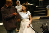 KAS338 Leonard Barrett escorts Dorothy, who's played by Juliet Villa, and Toto, played by Villa's...