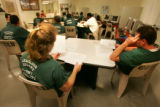Inmates attend an anger management class that is near full as overcrowding at county run jails is...