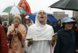 Lotus (cq, the name he gave me) plays finger symbols as he  and fellow members of the Hare Krishna...