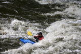 Don Dowling(cq), 33, surfs through the rapids in his white water kayak on the Platte River in...