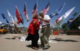 Sweethearts Alicia Villasana, 76, and John Garduno, 78, both of Trinidad, dance in the middle of...
